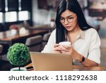 freelancer woman holding coffee ... | Shutterstock . vector #1118292638