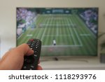 remote control in hand and... | Shutterstock . vector #1118293976