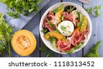 melon salad with mozzarella and ... | Shutterstock . vector #1118313452