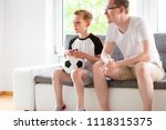 young father and his son... | Shutterstock . vector #1118315375