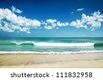 White Sand Beach And Blue Sky.