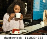 black woman drinking a coffee... | Shutterstock . vector #1118334338