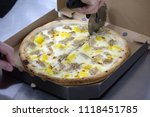 we cut pizza for the client  | Shutterstock . vector #1118451785
