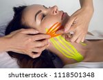 female cosmetician doing the...   Shutterstock . vector #1118501348