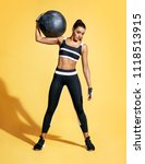strong woman with med ball on... | Shutterstock . vector #1118513915