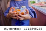 the child holding and offering... | Shutterstock . vector #1118545298