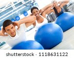 group of people working out at... | Shutterstock . vector #1118631122