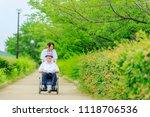 elderly men riding in... | Shutterstock . vector #1118706536