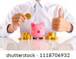 pink piggy bank with white... | Shutterstock . vector #1118706932