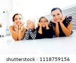 mature sisters twins at home... | Shutterstock . vector #1118759156