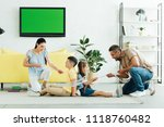 parents tying kids with rope at ... | Shutterstock . vector #1118760482