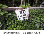 no parking sign on wooden fence.... | Shutterstock . vector #1118847275