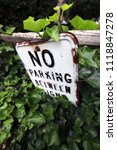 no parking sign on wooden fence.... | Shutterstock . vector #1118847278