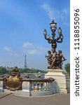 Small photo of Pont Alexandre III bridge decorated with ornate Art Nouveau lamps and sculptures and Eiffel Tower in the distance, Paris, France