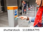 Stock photo validate a ticket at a validation machine for access to the underground city transport system 1118864795