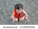 baby asia kid play on a beach.... | Shutterstock . vector #1118902046