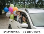 happy family holding colorful... | Shutterstock . vector #1118904596
