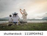 parent with young daughters and ... | Shutterstock . vector #1118904962