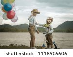happy boy and brother with... | Shutterstock . vector #1118906606