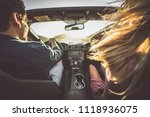 couple driving on a convertible ... | Shutterstock . vector #1118936075