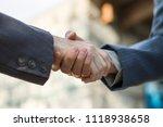 business partnership handshake... | Shutterstock . vector #1118938658