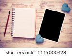 blank photo frame and notepad... | Shutterstock . vector #1119000428