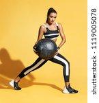 attractive woman doing exercise ... | Shutterstock . vector #1119005078