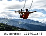 man swinging on swing at the... | Shutterstock . vector #1119011645