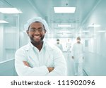 African Arabic doctor in hospital smiling - stock photo