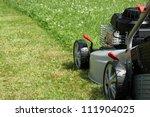 Silver Lawn Mower In The Garden.