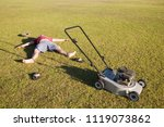an exhausted man lying on the... | Shutterstock . vector #1119073862