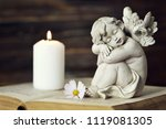 angel  white candle and flower... | Shutterstock . vector #1119081305