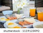 breakfast with hot dogs  fried... | Shutterstock . vector #1119123092