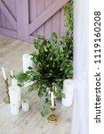white candles near wooden door... | Shutterstock . vector #1119160208