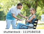young couple arguing while... | Shutterstock . vector #1119186518