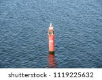 red navigational buoy in the sea | Shutterstock . vector #1119225632