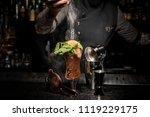 Bartender Adding Powder To A...