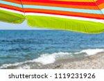 colorful beach umbrella on a... | Shutterstock . vector #1119231926