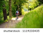 sportive middle age man cycling ... | Shutterstock . vector #1119233435