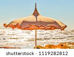 wind on orange stripes sunshade ... | Shutterstock . vector #1119282812