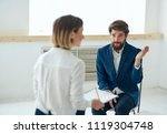 office interview man woman... | Shutterstock . vector #1119304748
