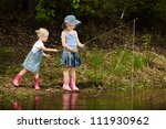 Little Girls Are Fishing On...