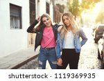two beautiful girlfriends... | Shutterstock . vector #1119369935