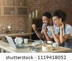 happy couple with raised arms... | Shutterstock . vector #1119418052