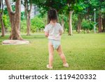 a little girl happy and walk in ... | Shutterstock . vector #1119420332