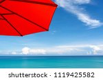 orange sunshade umbrella on the ... | Shutterstock . vector #1119425582
