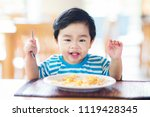 asian baby eating a breakfast... | Shutterstock . vector #1119428345