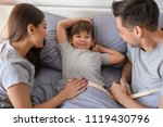 parents with little son in bed. ... | Shutterstock . vector #1119430796