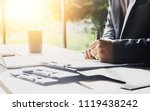 businessmen are check out... | Shutterstock . vector #1119438242