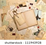 Stock photo old letters french post cards and empty open book nostalgic vintage background 111943928